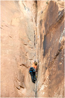 Climbing a cliff wall in the Navajo Sandstone